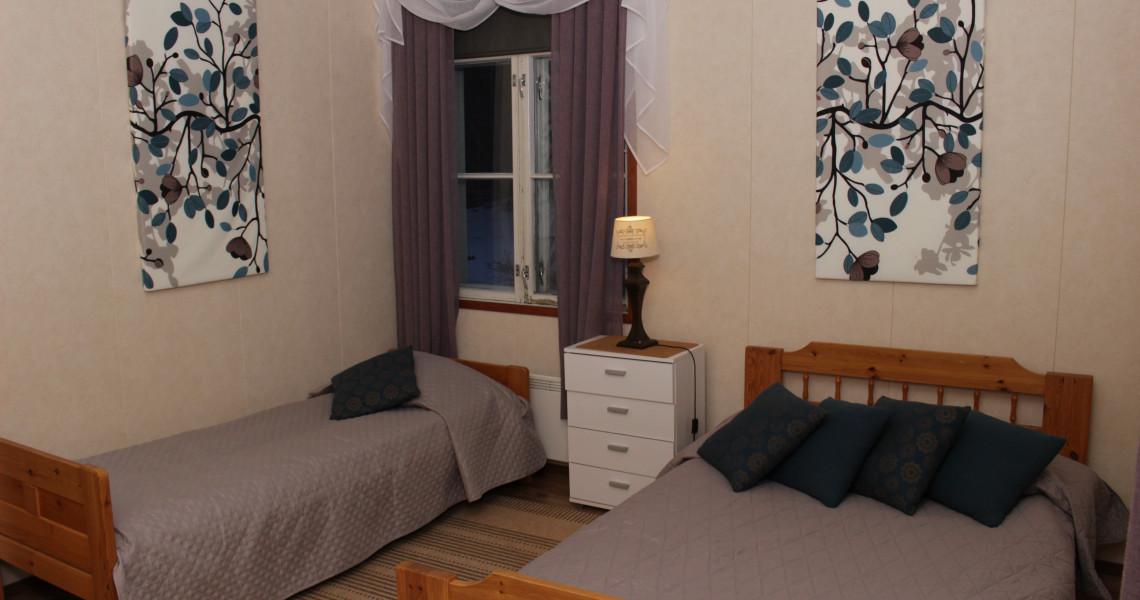 Suma-huoneiston makuuhuone